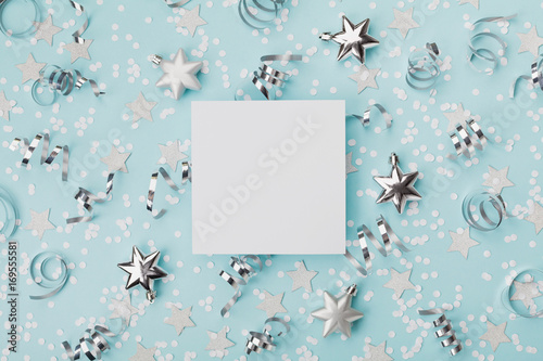 party carnival christmas mockup decorated confett and silver star on turquoise background top view flat