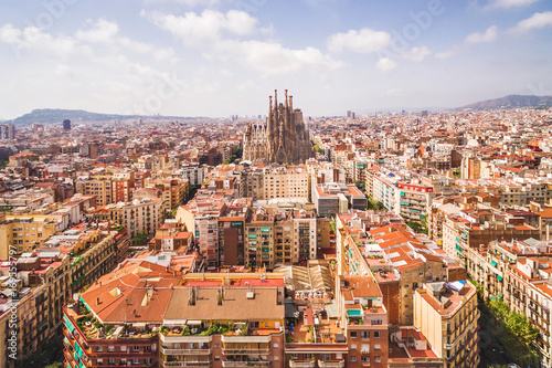 Barcelona city and La Sagrada Familia cathedral aerial view, Spain.