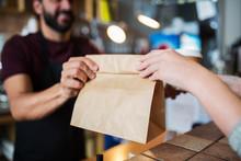 Man Or Bartender Serving Customer At Coffee Shop