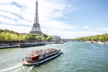 Landscpae View On The Eiffel Tower And Seine River With Tourist Boat In Paris