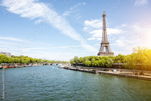 Landscape view on the Eiffel tower and Seine river during the sunny day in Paris