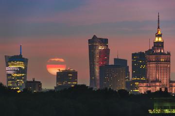 Sun over Warsaw city