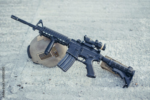 American assault automatic rifle with spotting scope and helmet Canvas Print