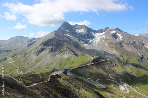 Fotobehang Landschap Scenic View Of Winding Road In The Mountains Against Cloudy Sky