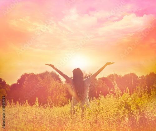 Obraz na plátně  Happy woman enjoying happiness, freedom and nature.