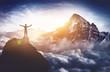 canvas print picture - Bergsteiger erlebt absolutes Gipfelglück hoch über den Wolken