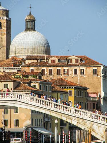 Fotografie, Obraz  Venice, Italy - Circa July 2015: Ponte degli Scalzi full of tourists and Chiesa
