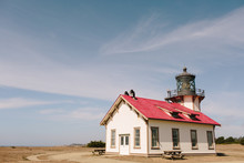Red And White Lighthouse On Th...