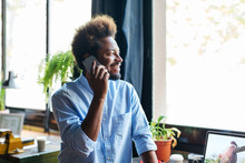 Young Entrepreneur Chatting On Phone In A Creative Office.
