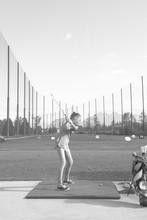 Teen Girl Playing Golf