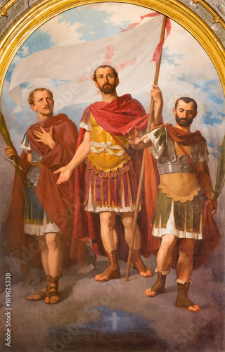 TURIN, ITALY - MARCH 15, 2017: The painting of three early christian holy martyrs and soldiers in church Basilica Maria Ausiliatrice by Enrico Reffo (1893) Poster