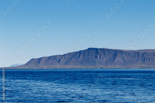 Icelandic landscape with mountains and ocean.