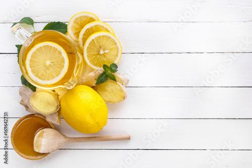 Tea, lemon, ginger, honey and mint on white boards Wallpaper Mural