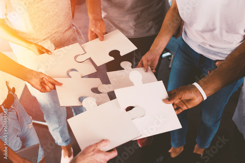 Photo  Team of businessmen work together for one goal