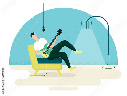 Valokuva Young man enjoying singing and playing guitar in living room