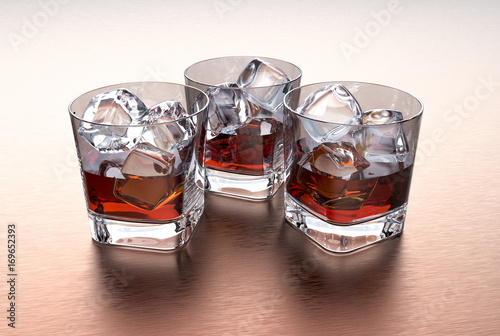 Three glasses of whiskey with ice cubes on a metal table Wallpaper Mural