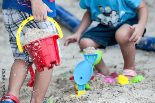 Photo  Kids on white sand Sandbox And antimony of children play