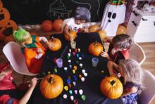 Kids Painting A Pumpkin For Ha...