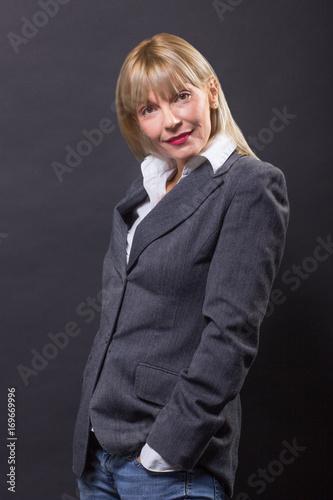 Poster  mature woman 40s black cheerful, looking at camera.