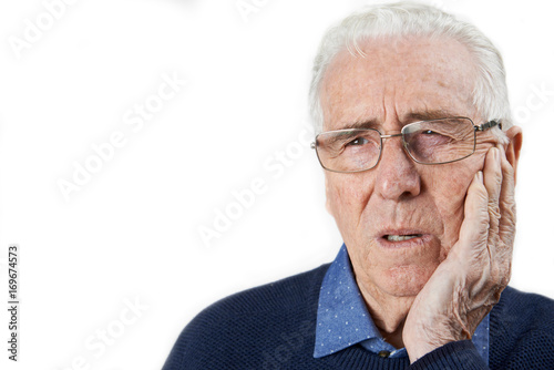 Fotografia  Studio Shot Of Senior Man Suffering With Toothache