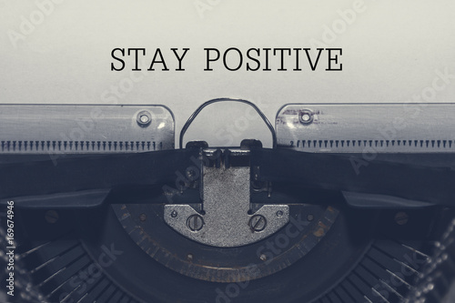 """Photo  On the page with typewriter old with the text """"stay positive"""""""