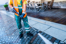 Worker Cleaning The Cobbled St...