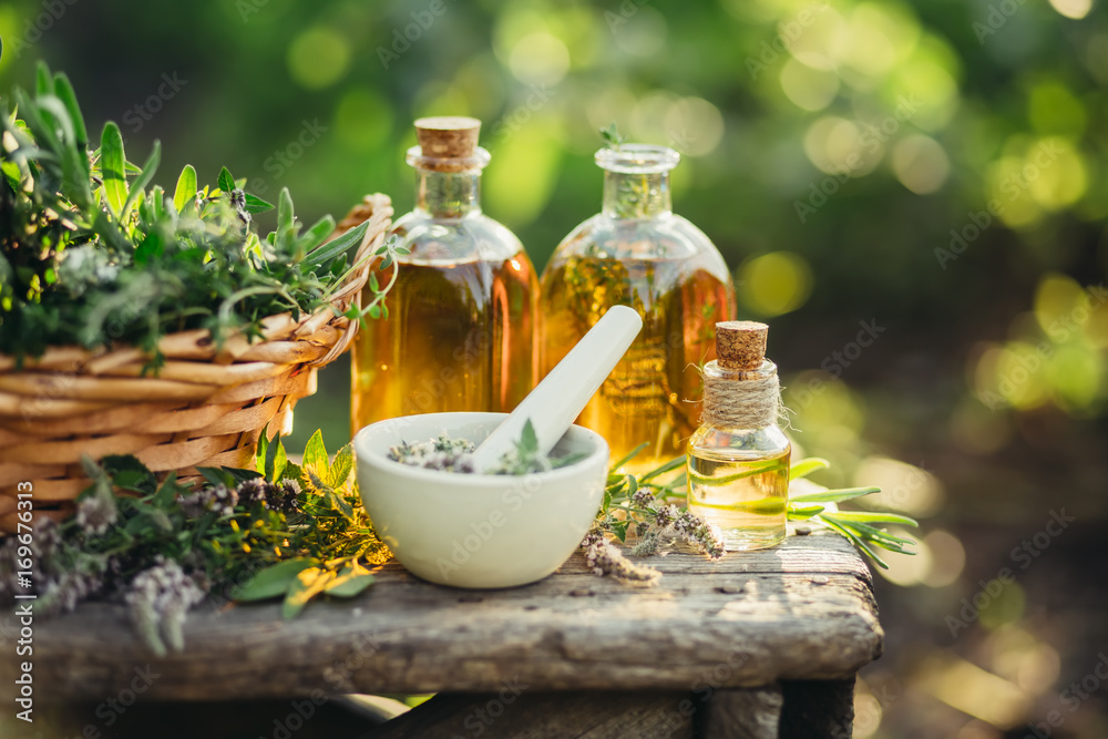 Fototapety, obrazy: Spa composition with Fresh herbs and different types of oils.