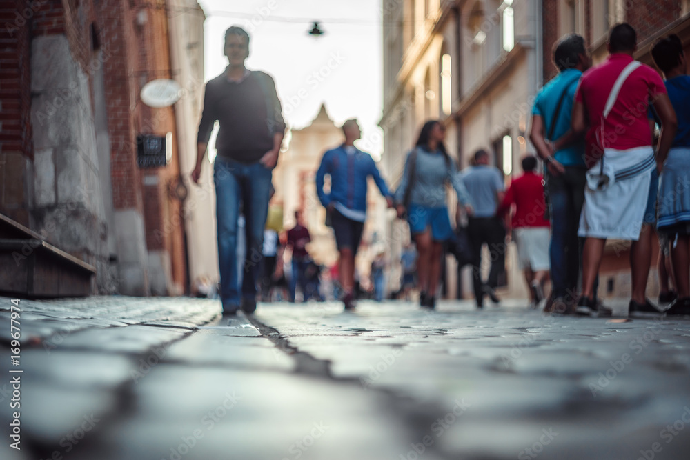 Fototapety, obrazy: Blurred people walking and standing on the street