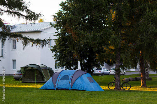 Photo Stands Camping Blue tent on green lawn
