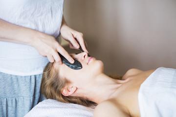 Obraz na płótnie Canvas Young woman have face treatment at beauty clinic