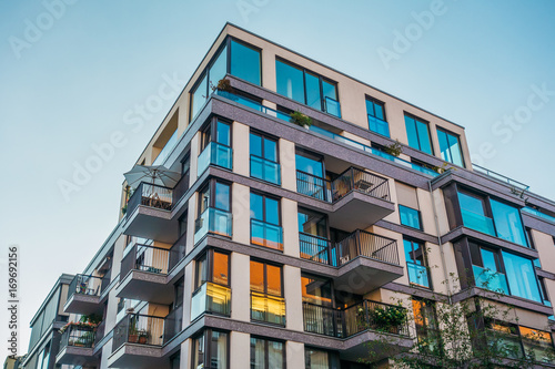 modern corner apartment complex with blue colored windows and light leaks Wallpaper Mural