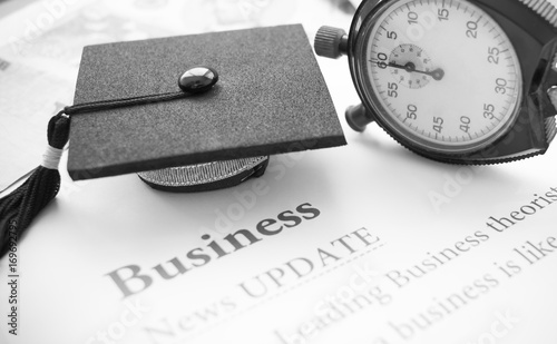 Time is Education, Graduation cap and Clock on papers letter
