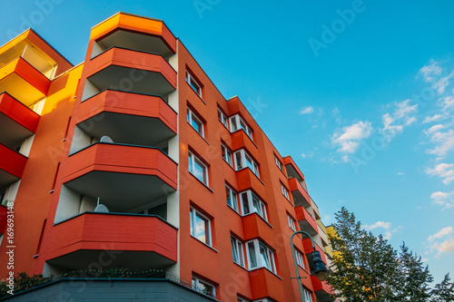 red corner building with big balcony Canvas Print