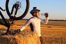 Cyclist Drinks Water From Bott...