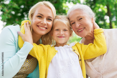 woman with daughter and senior mother at park Wallpaper Mural