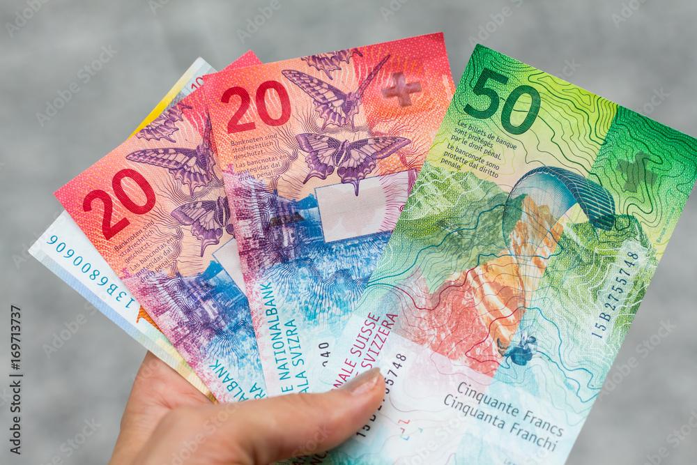 Fototapeta Set of swiss franc banknotes isolated on grey background