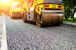 canvas print picture - Background of asphalt roller that stack and press hot asphalt. Road repair machine