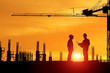 Silhouette of architect and onstruction worker