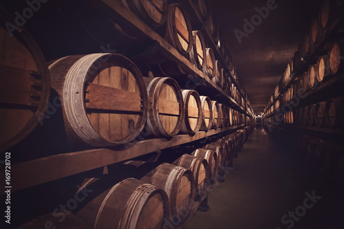 Canvastavla Wine cellar with a row of barrels