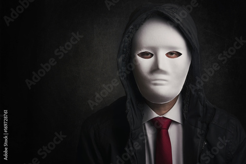 hombre de negocios con mascara Fototapeta