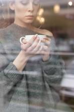 Woman Having Coffee Seen Throu...