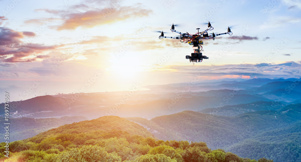 Fototapety, obrazy: The drone with the professional camera takes pictures of the misty mountains at sunset