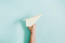 Women Hand Holding Paper Plane...