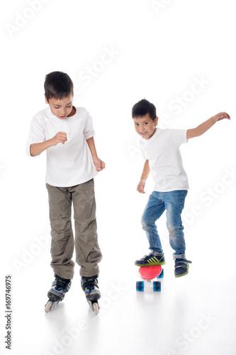 Printed kitchen splashbacks Artist KB Two boys ride roller skates and a board.