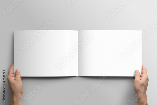 Spoed Foto op Canvas Wit Blank A4 photorealistic landscape brochure mockup on light grey background.