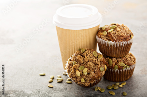 Healthy pumpkin muffins with coffee to go