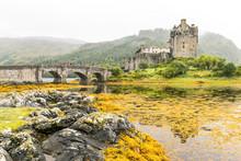 Eilean Donan Castle In Highlands Mountains In Scotland