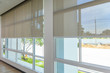 Leinwanddruck Bild - Roll Blinds on the windows, the sun does not penetrate the house. Window in the Interior Roller Blinds. Beautiful Blinds on the Window, the Sun and Heat Protection, the Perfect Windows Interior Decor
