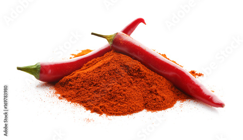 Poster Hot chili peppers Pile of red chili powder with whole pepper pods isolated on white