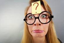 Weirdo Nerd Woman Having Question Mark On Forehead